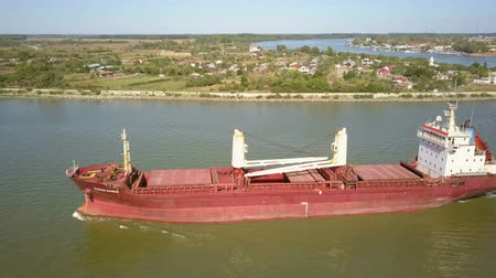 nakládané : Tulcea, Romania - 15 September 2019: Cargo ship on the danube river, aerial view Dostupné videozáznamy