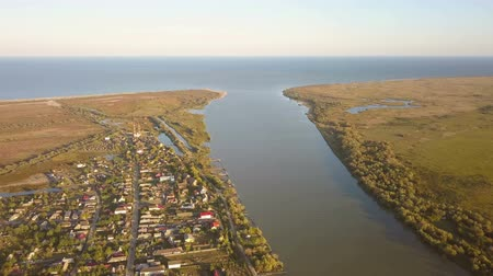 docking : Old fishermen village (Saint George) and Danube flowing into the Black Sea, aerial view