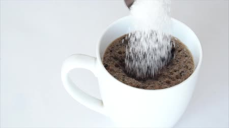 глыба : Slow motion sugar falling in a cup of coffee against a white background