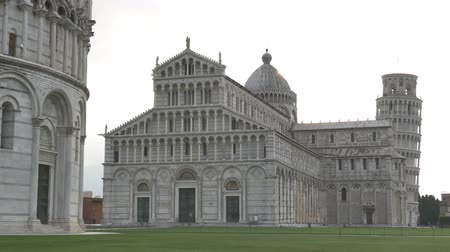 hajló : Piazza dei Miracoli, in foreground the Baptistry, the Dome and the leaning tower of Pisa, Italy, Europe.  Stock mozgókép