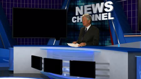 kotva : News Broadcaster Reads Copy in the News Channel Studio. Dostupné videozáznamy
