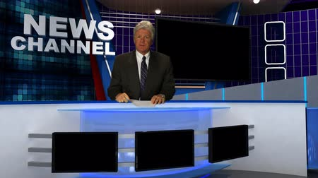 breaking news : News Broadcaster Reads Copy in the Studio. Stock Footage