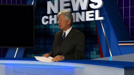 jornalismo : News Anchorman Reads Copy in the Studio.