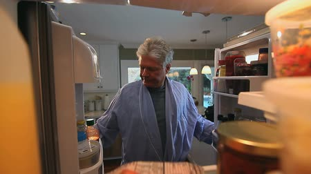 famished : Hungry Man Opens Refrigerator to Look for Something to Eat.  POV.