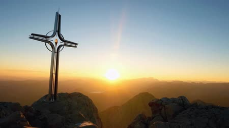 evangelical : Time lapse of the Alps daybreak. Iron Cross at mountain top in the Alps. Cross on top of mountains, and as typical peak in the Alps. Monument to the dead climbers