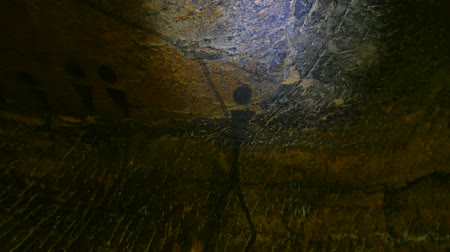 mamut : Buffalo hunting. Paint of human hunting on sandstone wall, prehistoric picture. Black carbon abstract art children in sandstone cave. Spotlight shines on caveman painting in cave