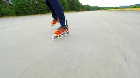 roller blading : Roller skates in movement. Hradcany airport, 9th of July 2019. Training of inline skating on concrete surface of abandoned airport. Stock Footage