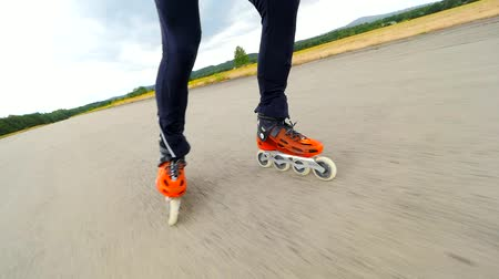trousers : Roller skates in movement. Hradcany airport, 9th of July 2019. Training of inline skating on concrete surface of abandoned airport. Stock Footage