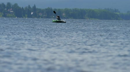 splendid : Boy in green kayak sail on pond. Sunny day on wonderful lake. 15th of July 2019, Lipno lake, Czech Republic. Summer time