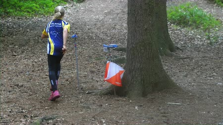 Person run hard to check point. Outdoor orienteering check point activity. Sport competition, 17th of August 2019. Mladejov, Czech Republic.