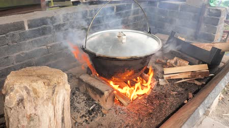 caldo : BBQ fire. Big enamel pot with chicken broth