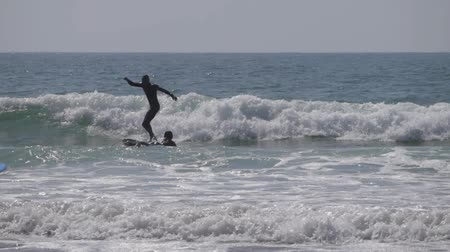 marrocos : surfers on sea morocco 3