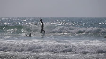 many surfers : pro surfer ride on head, morocco