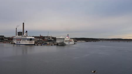 námořník : Two Ferries moored At Dock At A Ferry Terminal