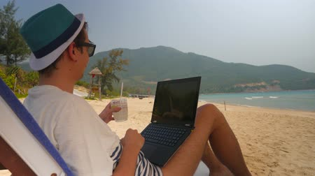 success : relaxed business Man finish success deal during vacation