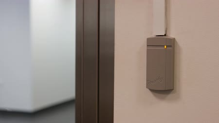 elektronický : mans hand open secure door with key card