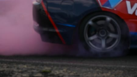 andarilho : Blurred close up of drifting car wheels and red smoke