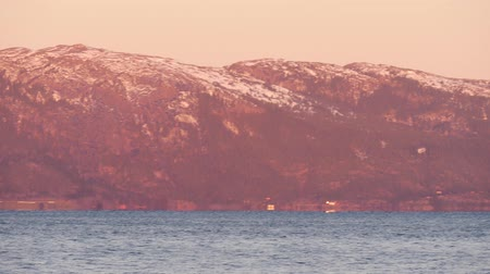 trondheim : View from the sea on a long mountain along the shore. Trondheim fjord, Norway. Panning from left to right. Stock Footage