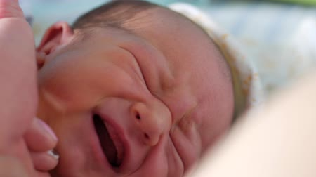 wrapped up : Awakend baby yawn and starting to cry