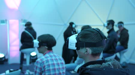 showcase : Los Angeles, USA - September 11, 2016: Men tries virtual reality Samsung Gear VR headset during VRLA Expo Winter, virtual reality exposition, at the Los Angeles Convention Center.