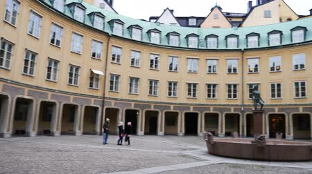 chancellery : Brantingtorget public square surrounded with the building of Annex of the Chancellery and fountain in the middle, Stockholm. Panning from left to right