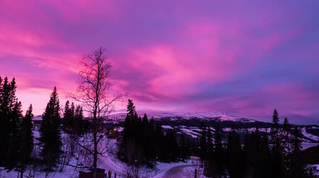 trondheim : Wonderful pink clouds at sunset time over the winter mountain landscape. Timelapse. Sweden, 4k UHD 2160p