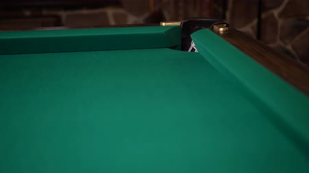 tágo : Direct hit into the pocket in a corner of a green billiards table