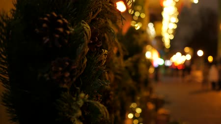defocus : Handheld shot of christmas decorations at illuminated street Stock Footage