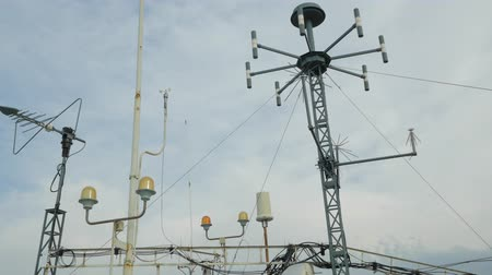 hava durumu : Weather station witn antennas and meteo equipment against overcast sky. Handheld shot Stok Video