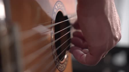 spanish style : Musician plays acoustic spanish guitar. Close up shot of right hand, shallow depth of field Stock Footage