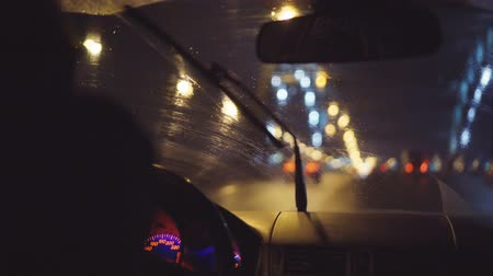 gösterge paneli : Driving at rainy night. Blurred city lights through windshield Stok Video