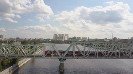 water rail : Electric train crosses a railway bridge over Moskva River in Mocow