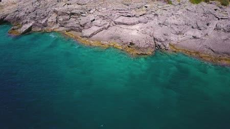 denteado : Rocky shore of clear Adriatic sea. Sea bottom is vidible through turquoise water. Aerial shot