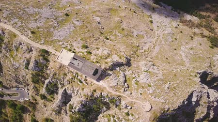 lovcen : Aerial shot of mausoleum on the top of Lovchen mountain at sunny day, Montenegro Stock Footage