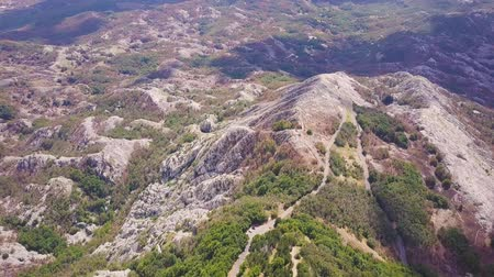 lovcen : Aerial of woody ridge and hazy mountains in the distance, Montenegro