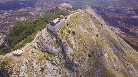 lovcen : Mausoleum on the summit of Lovchen mountain, Montenegro. Flying over ridge at sunny day