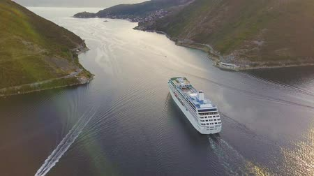 adriático : Big white cruise liner enters the narrow straits of Verige at the Bay of Kotor. Aerial view