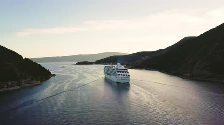 kotorska : White cruise ship floats through narrow straits of Verige between mountains. Aerial view