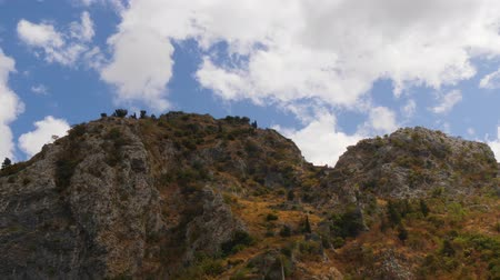 john : Ancient walls of Kotor fortress at Saint John mountain under clouds in blue sky