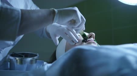 woman waxing : Beautician applies green hot wax on womans face for moustache removment
