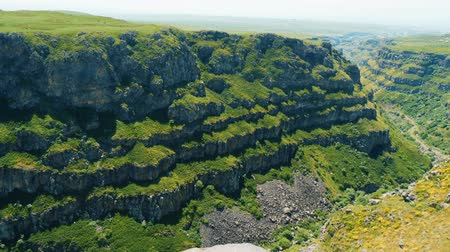 armenia : Stepped rocky slopes of deep canyon. Panning view of Kasagh Gorge, Armenian mountains