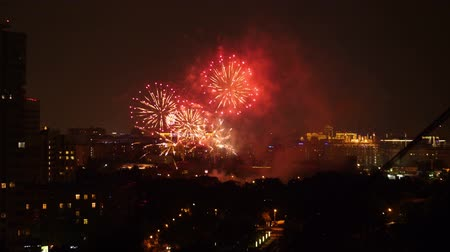 ünnepélyes : Greate colorful fireworks above the city, big bursts of salute in dark night sky Stock mozgókép