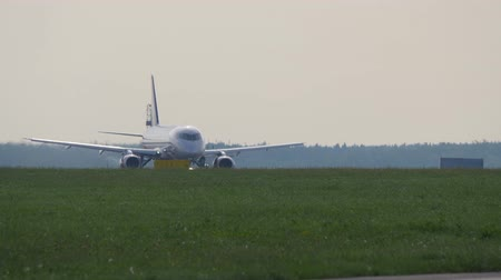 маркировка : Takeoff run of passenger airplane. Airliner takes off from runway in Sheremetyevo