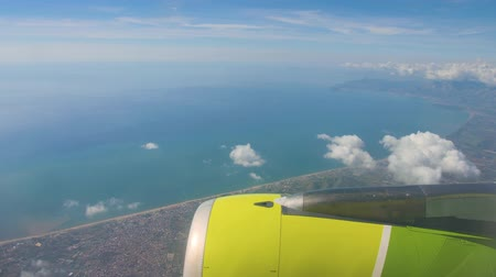 Flying over Gulf of Naples. View on blue sea and city on a shore from airplane Stok Video