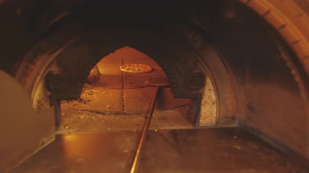 Brick oven with burning firewood, pizza and long peel. Italian fire baked pizza Stok Video