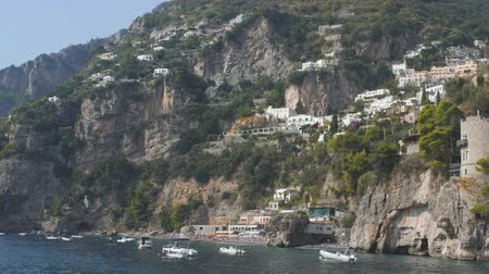 amalfi : White mediterranean villages on slopes ща mountain. View from sea. Lots of boats along shore