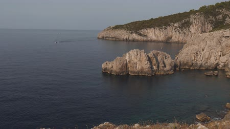 Coastline with blue bays and steep rocky cliffs. Sea shore on sunny day, Italy Stok Video