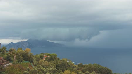 Storm cloud over Capri island. Heavy rain, thunderstorm and lightning over sea