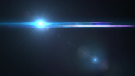 parlayan : Lens Flares crossing Sea Blue vertical Stok Video