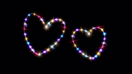 double happiness : dark background with heart forming from stars Stock Footage